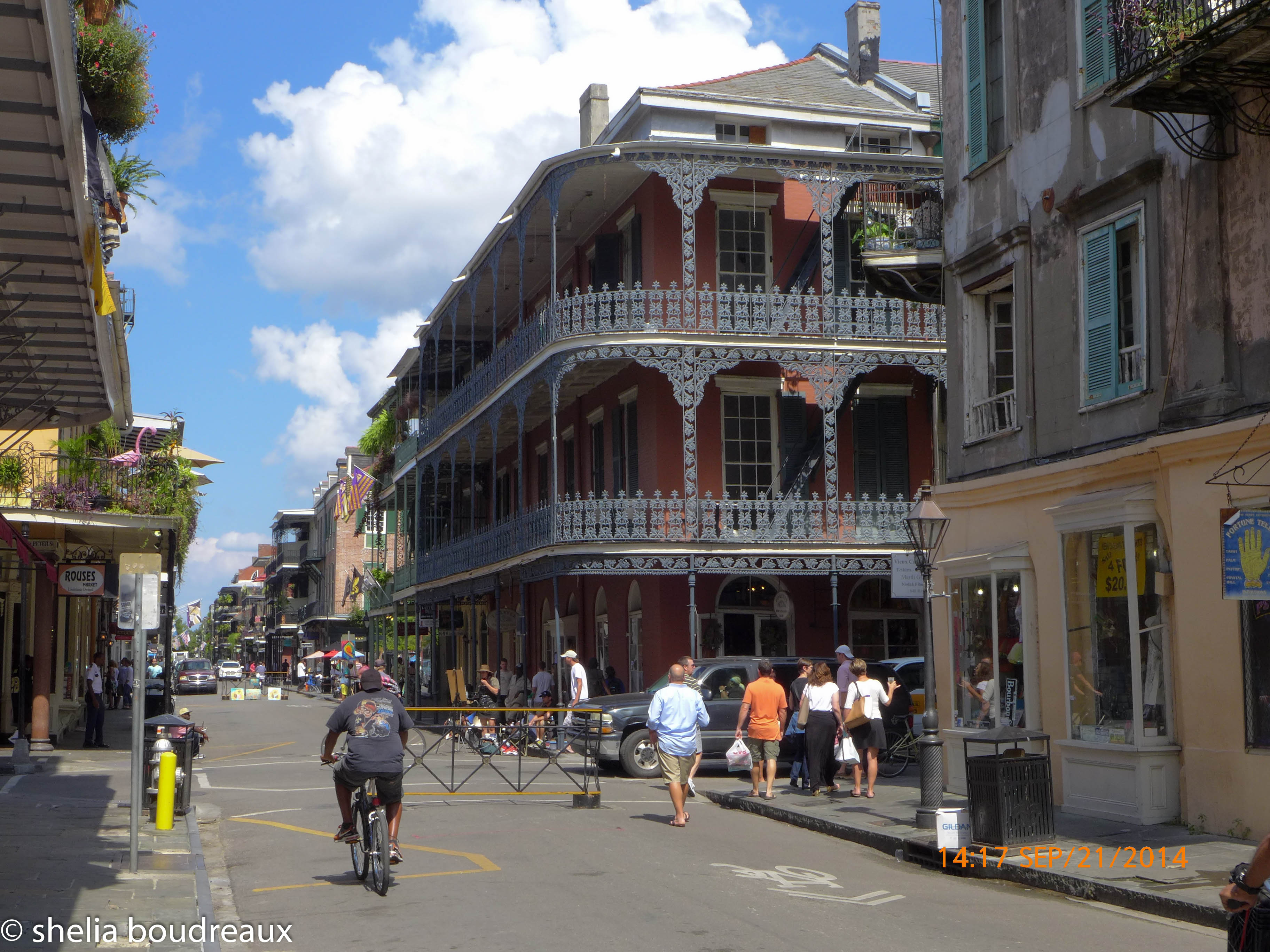 This is typical French Quarter architecture.  The Spanish occupied Louisiana and had much influence on the way the balconies were done.  This style can be seen in parts of Spain now days as well.